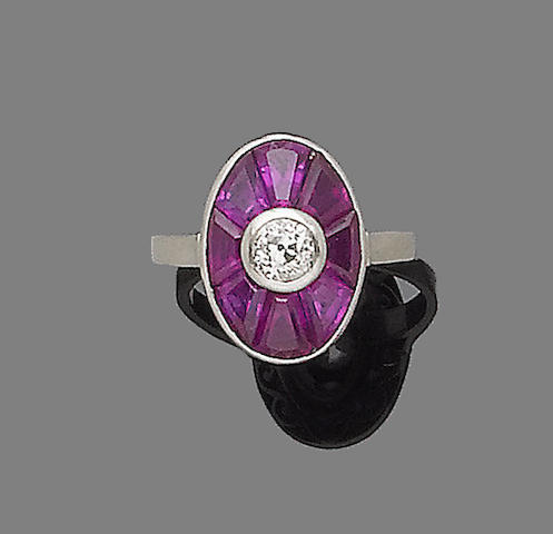 An art deco ruby and diamond target ring,