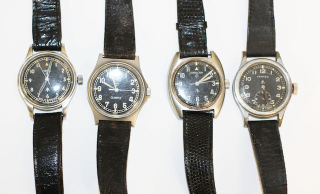 Four 20th Century black faced military watches