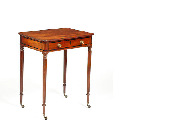 A George IV mahogany small writing table in the manner of Gillows