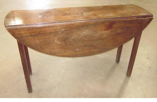 A George III mahogany wakes table, 130cm long.