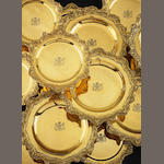 An early 19th century suite of eighteen silver gilt plates by Benjamin Smith, all stamped B.Smith, Duke Street, Linn Inn Fields