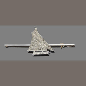 A diamond bar yacht brooch,