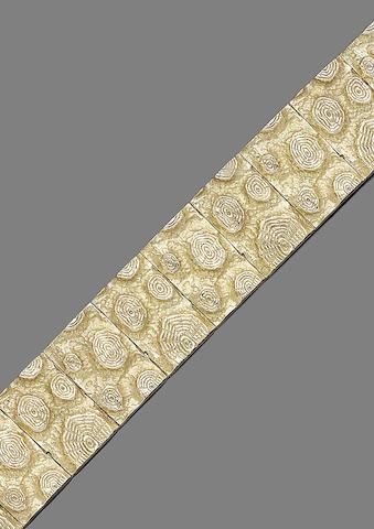 A gold bracelet,