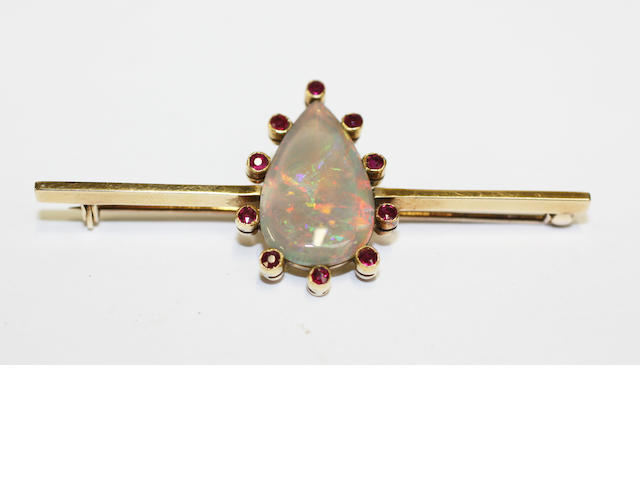 An opal and ruby bar brooch,