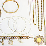 A collection of assorted gold jewellery, including two ropetwist chains, stamped '9kt', a curb-link charm bracelet, a hinged bangle, stamped '750', three stiff bangles, stamped '585', a three colour fringe necklace stamped 'k9', a snake-link bracelet stamped '750', and an Austro Hungarian coin brooch, gross weight approximately 130gm.