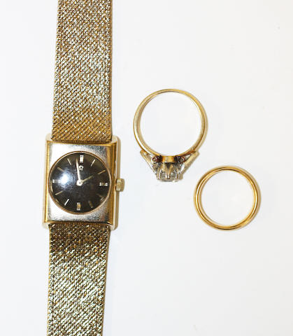 A wristwatch, a wedding band and a diamond solitaire ring, (3)