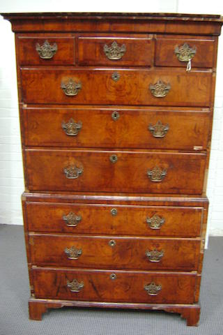 A George I Walnut tallboy with Cavetto cornice about three short and six long graduated drawers, 105cm wide, 171cm high