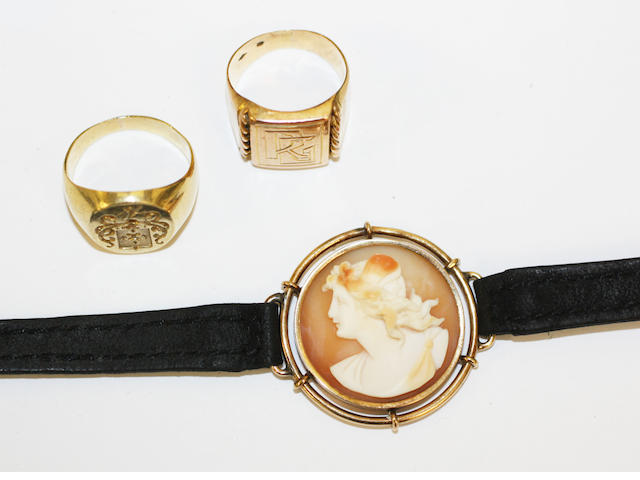 A shell cameo bracelet and two signet rings, (3)
