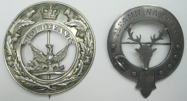 Two 19th century silver clan badges
