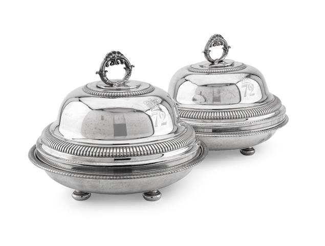 A pair of George III vegetable dishes and covers by Paul Storr, London 1818, marks to the bases very rubbed