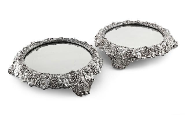 A pair of Victorian mirror plateaux by Elkington & Co