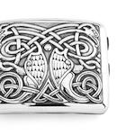 A silver cigarette case  designed by Alexander Ritchie of Iona, made by Saunders & Shepherd, Chester 1917