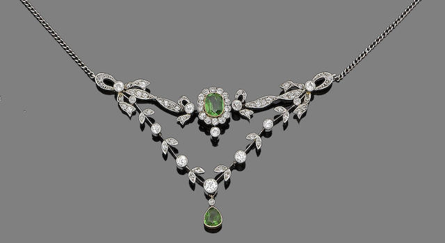 A demantoid garnet and diamond pendant necklace