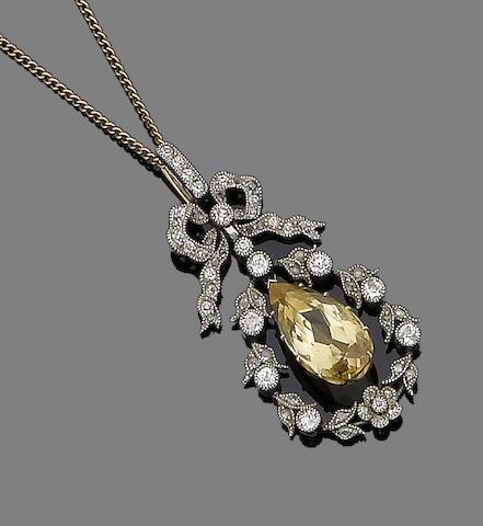 A topaz and diamond pendant necklace,