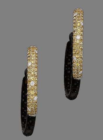 A pair of yellow sapphire and diamond earhoops