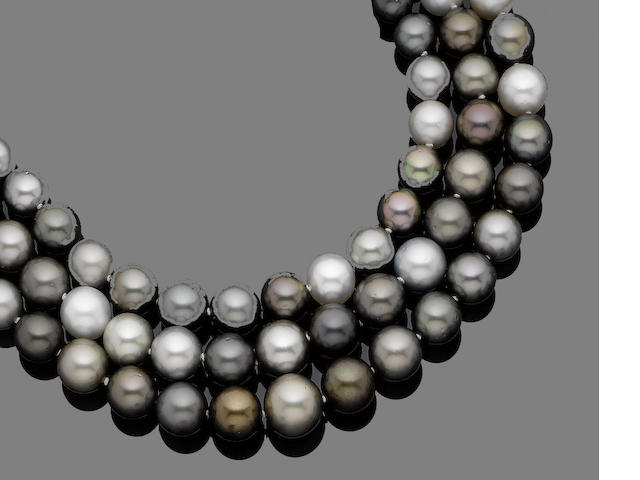 A three-strand cultured pearl and diamond necklace