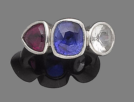 A sapphire and ruby three-stone ring