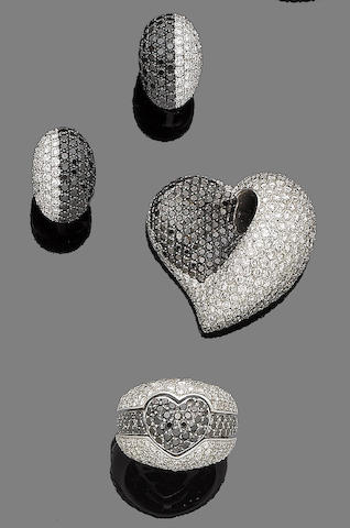 A diamond and treated black diamond heart pendant, earclips and ring suite (3)