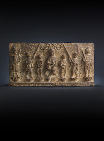 A rare early stone plaque depicting Guanyin and six attendants 13th century