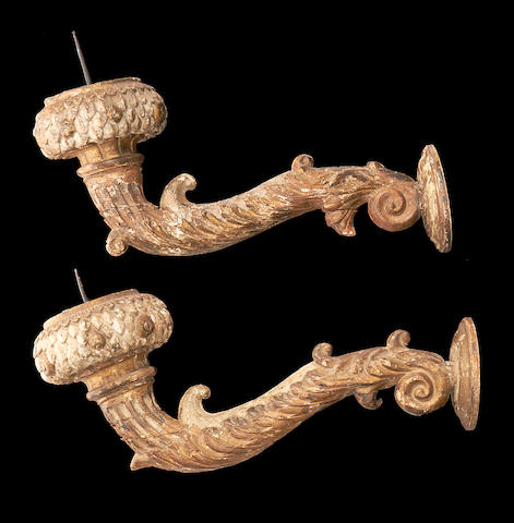 A pair of 18th century Italian carved giltwood wall lights