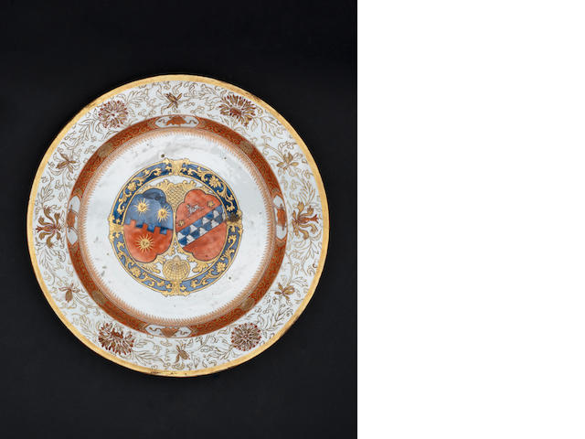 A rouge-de-fer decorated armorial dish 18th century
