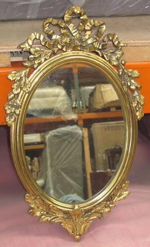 An early 20th Century gilt framed oval wall mirror,