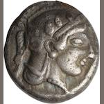 Attica, Athens, Drachm, 467-463 BC 4.23g. Starr Group IIC-87 (same dies). This is an extremely important coin. It is from Starr Group II, where very few drachmas (10) have thus far been recorded. The head is wonderfully centered and shows most of the crest of the helmet, the hair below the helmet, the complete neck, as well as the pearl necklace that Athena wears. The reverse is nearly complete, only missing the owl's tail feathers. AΘΕ is to the right of the owl. The drachmas of the entire Starr Group period are extremely rare and those as early as Group II are almost impossible to find. Only one coin of this class pictured in Starr is better than this example.
