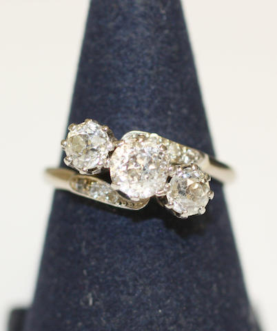 Diamond three-stone crossover ring