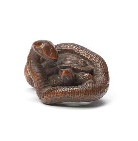 A wood netsuke of a snake and tortoise Early 19th century
