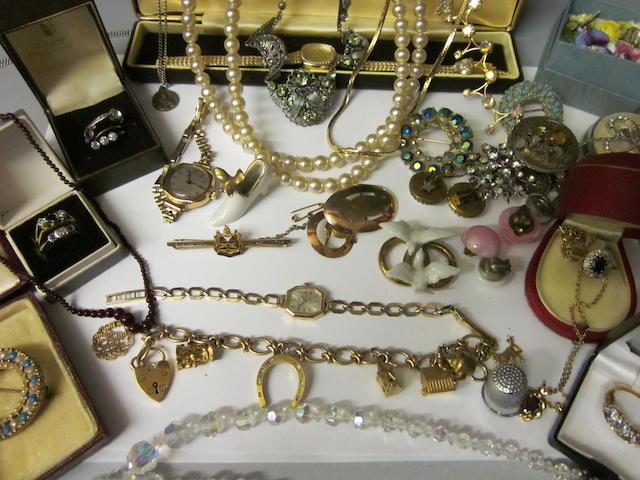 A 9 carat gold charm bracelet, (Qty)