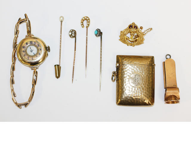 A vesterm cigar cutter, wristwatch, a brooch and 4 stick pins,