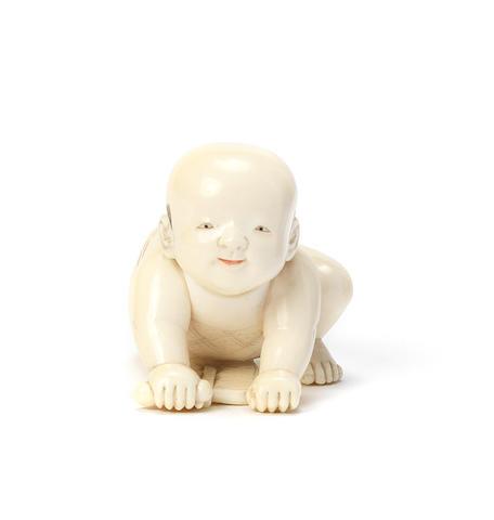 An ivory netsuke of a baby boy By Ono Ryomin, Edo, 19th century