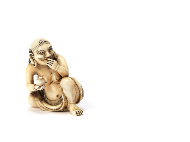 A rare ivory netsuke of a rakan By Yoshinaga, Kyoto, early 19th century
