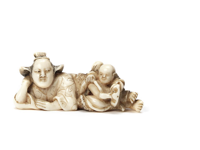 An ivory netsuke of a woman and child 19th century