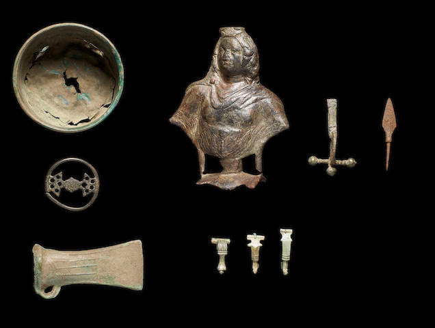 A group of Ancient bronze objects and an iron arrow head, 10