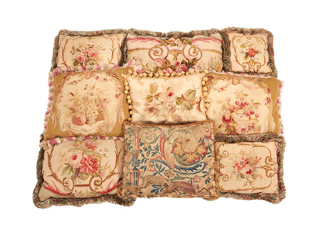 A collection of ten needlework and aubusson tapestry cushions