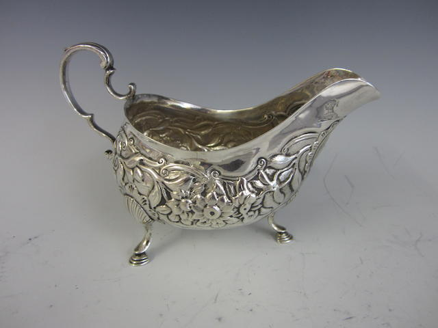 A George III silver presentation gravy boat by Matthew West, Dublin 1793