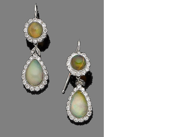 A pair of opal and diamond pendent earrings
