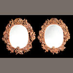 A pair of German late 19th century walnut mirrors
