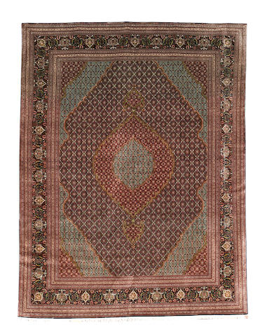A Tabriz carpet, North West Persia, 390cm x 310cm