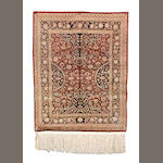 A Hereke silk rug, West Anatolia, 130cm x 102cm, signed