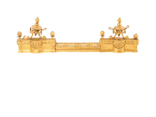 A mid 19th century Louis XVI style gilt bronze fender