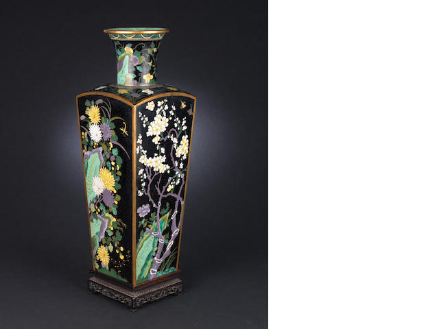 A black ground, squared tapering cloisonné vase