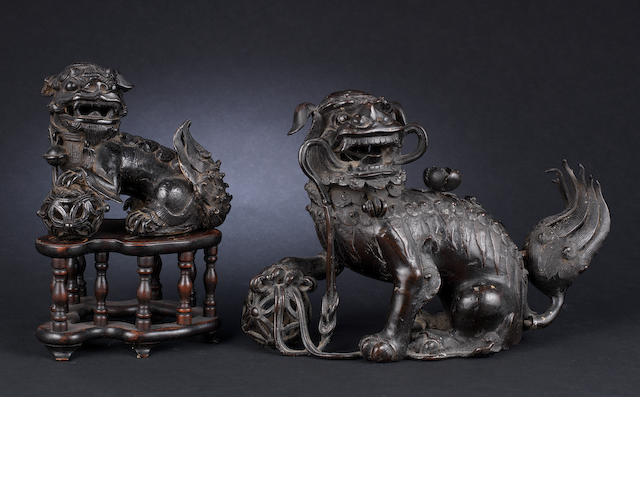 Two smaller Buddhistic lions Ming or Qing Dynasty