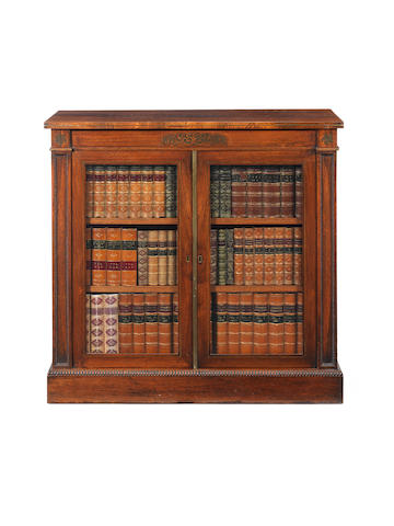 A small Regency rosewood and brass inlaid side cabinet Gillows?
