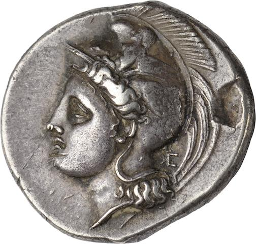 Bruttium, Velia, Stater, c. 360-350 BC 7.7g. Obverse: Helmeted head of Athena left. Reverse: Lion feeding left, ΥΕΛΗΤΩΝ below. The letters are elongated and stretch to the border.