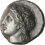 Chalcidian League, Olynthus, Tetradrachm, c. 380 BC 14.34g. Robinson-Clement-81. Obverse: Laureate head of Apollo facing left. An unusually high-relief portrait of a mature Apollo with long, flowing hair and beautifully detailed wreath. Reverse: Lyre, KPA underneath, EΩΝ is to the left, ΛΚΙΔ is to the right. Reverse is slightly off center, with a tripod symbol above the lyre.