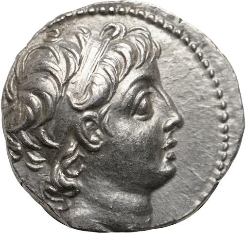 Seleukid Kingdom, Demetrius II, 145-138 BC, Drachm, Seleuceia Pieria 4.19g. Babelon-934; American Journal of Numismatics, Three Seleucid Notes, Hoover, 3; Spaer-1634. Obverse: Diademed head facing right. Reverse: ΒΑΣΙΛΕΩΣ ΔΗΜΗΤΡΙΟΥ ΝΙΚΑΤΟΡΟΣ, vertical anchor, flukes upward; lily to upper right of anchor. This is probably one of the finest examples of the king who ruled competitively against Antiochus VI. The anchor type is extremely rare and this is probably the finest known example. Obverse struck in high relief, a well preserved example of this scarce type.