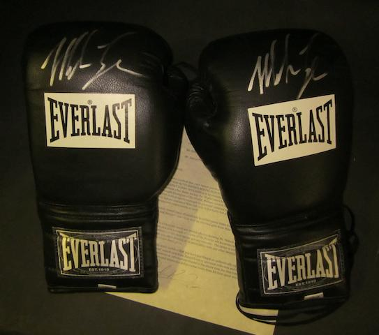 Mike Tyson hand signed boxing gloves used in training in the lead up to the Danny Williams fight