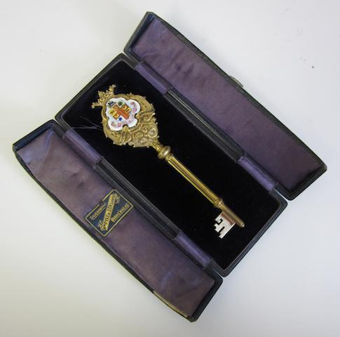 Of Birkenhead Interest; An Edwardian silver-gilt and enamel presentation key by Morgan and Boon, Birmingham 1905